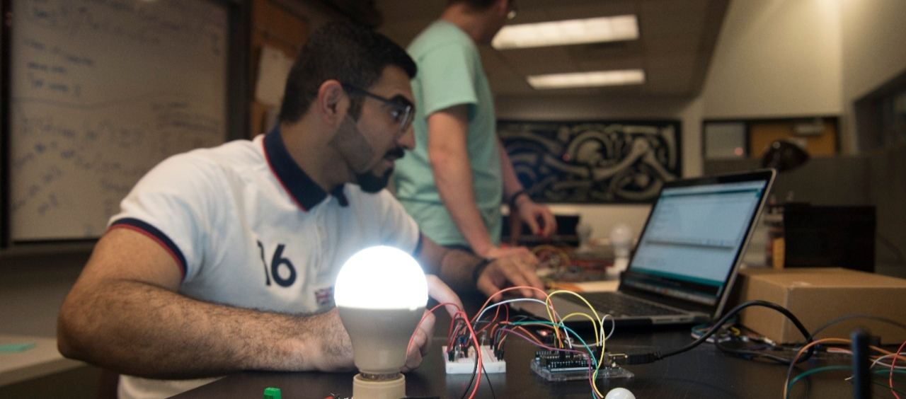 An engineering technology student working on a research project