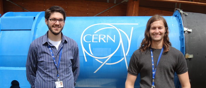 Students standing in front of the CERN sign