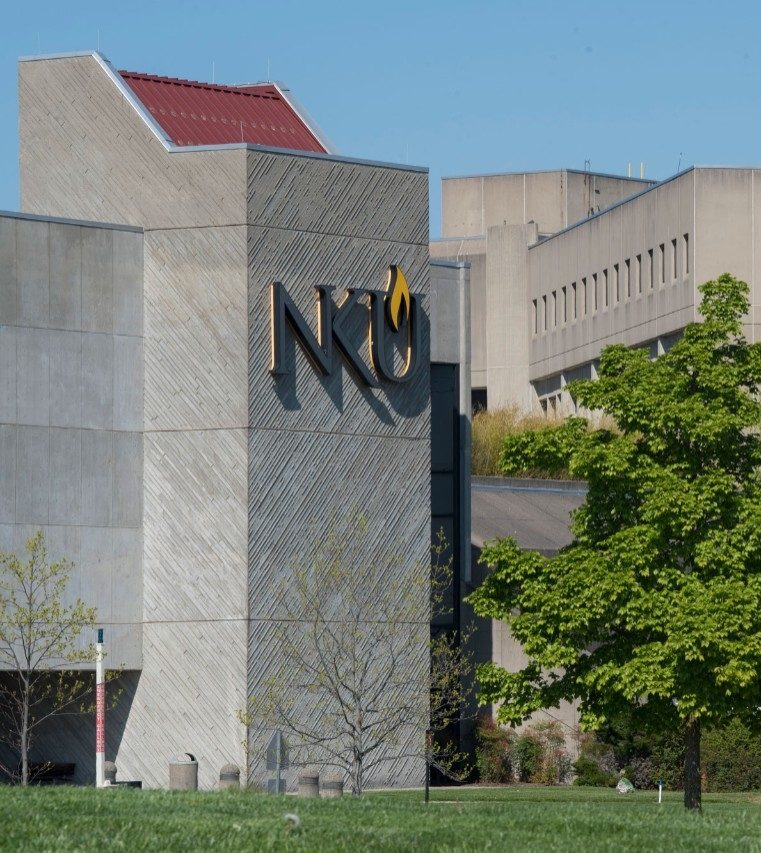 Scenic view of NKU's Steely Library building showing the NKU logo on the building side.